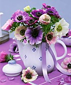 Posy of anemones in blue and white pot