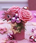 Arrangement of pink roses, Douglas fir & Christmas baubles