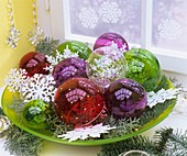 Bowl of transparent Christmas baubles and stars