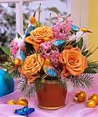 Arrangement of roses, hyacinths, Douglas fir & glass birds