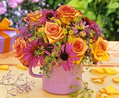 Arrangement of roses, fennel & purple coneflower in small jug