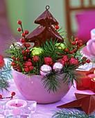 Christmas arrangement of Douglas fir and winterberries