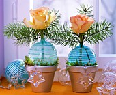 Roses and greenery in turquoise Christmas baubles