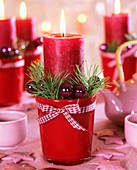 Advent candles (Red pillar candles with Christmas decorations)