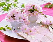 Ornamental cherry blossom in cup and eggcup