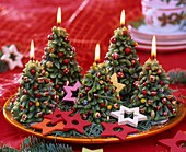 Advent wreath: Christmas tree-shaped candles on plate