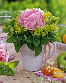 Peony in 'frill' of lady's mantle and peppermint