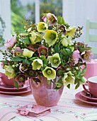 Vase of Christmas and Lenten roses and wax flowers