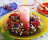 Wreath of roses, hydrangeas & gypsophila around windlight