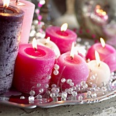 Christmas decoration: burning candles and beads