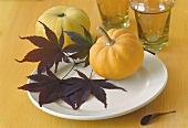 Autumn table decoration: leaves and pumpkins