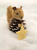 Christmas biscuit and squirrel in snow