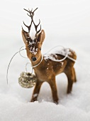 Deer figure in snow (Christmas decoration)