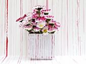 Daisies in ceramic vase