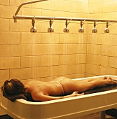 Woman lying on spa treatment table