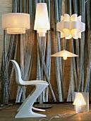 Various designer lamps and 50s shell chair in lighting designer's workshop