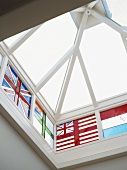 Roof lantern with white wooden frame and stained glass windows with national flag motifs