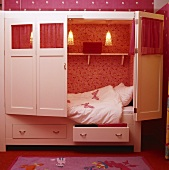 Alcove-style cupboard bed with butterfly motif in child's bedroom