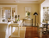 Pale living-dining room in white and natural shades with vintage, country-house-style decor