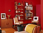 Retro interior with 70s wall-mounted shelves and deer's head sculpture against bright red wall