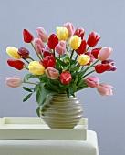 Mixed tulips in ceramic vase
