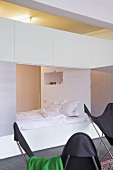 Double cubby bed with small niche used as shelf
