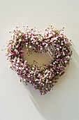 Heart-shaped wreath of pink baby's breath (overhead view)