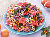 Wreath of late summer flowers on plate