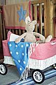 Plush bunny & blanket in toy pram