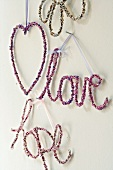Beaded wall decoration (heart, the words 'love' and 'hope')