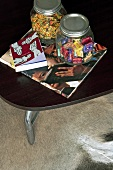 Jars of sweets, book and magazine on a coffee table