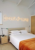 Bedroom with decorative lighting