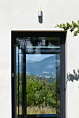Window with view of landscape (Villa Nalu, Southern France)