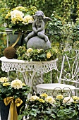 White hydrangeas and a cherub on a terrace