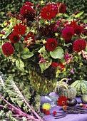 Autumnal arrangement in shades of red (with dahlias etc.)