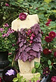 Garden decoration: torso with corsage of flowers & leaves