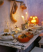 Pumpkin stew on table laid for Halloween