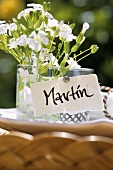 Place card with flowers in open air