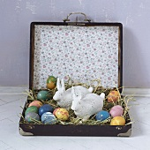 Easter eggs and bunnies in a suitcase