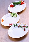 Three plates with vegetable decorations