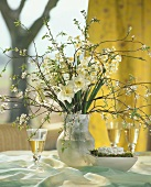 Spring arrangement of narcissi and blossom