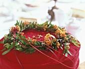 Asclepia wreath on ring cushion