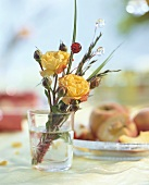 Posy of roses in a glass