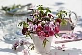 Arrangement of Bellis, peach blossom and beech leaves