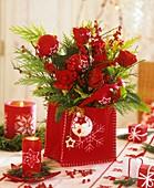Arrangement of roses in a felt bag (Christmas decoration)