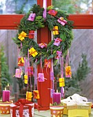 Advent calendar in form of wreath with parcels