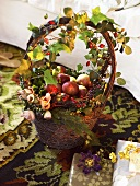 Decorated basket of apples and roses