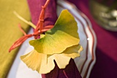 Yellow gingko leaves as table decoration