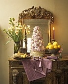 Tower of poached meringues, chocolate cream, flowers, sugar pearls