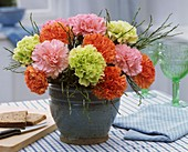 Arrangement of carnations and blueberry twigs